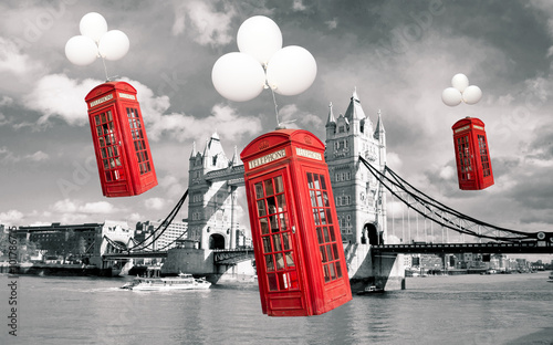 english phone booths flying above the tower bridge