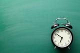 alarm clock on chalkboard