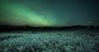Aurora Borealis over frozen farmland