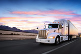 Fototapety Truck and highway at sunset - transportation background