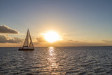 Fototapety Yacht in the tropical sea at sunset