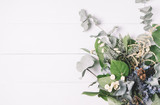 Bouquet of dried wild flowers on a white background of vintage wooden planks top view horizontal - 101926737