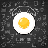 Fried egg and hand drawn watercolor alarm clock on textured blac