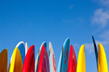 Stack of surfboards with sand on surface - 101944136