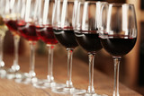 Many glasses of different wine in a row on bar counter - Fine Art prints