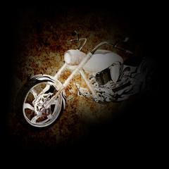 Chopper motorbike on a dark background. © drstokvektor