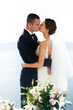 Newlywed husband and wife kissing sea background closeup, Santor