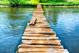 Fototapety Old wooden bridge through the river