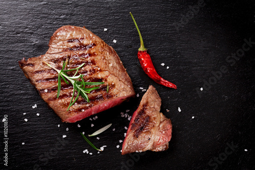 Poster Grilled beef steak with rosemary, salt and pepper