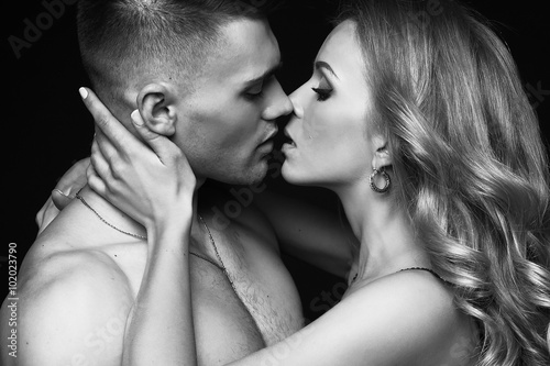 fashion studio photo of impassioned beautiful couple. sexy woman with blond hair and handsome brunette man