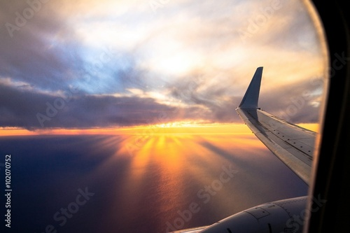 Poster Wing aircraft at sunset. Looking Out Through Airplane Window