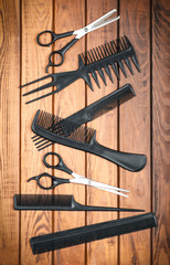 Professional hairdresser tools on wooden table close-up
