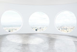 Fototapety Light loft room with round windows and concrete floor