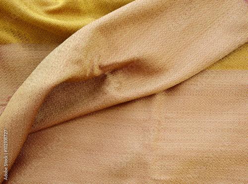 Fotobehang Stof silk golden fabric texture