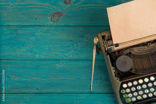 typewriter on the blue wooden desk