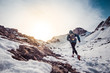 Man running on the snow on a mountain