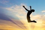 Fototapety Silhouette happy man jumping