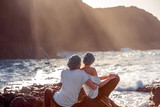 Couple together on the rocky coast