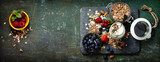 Fototapety Healthy breakfast of muesli, berries with yogurt and seeds