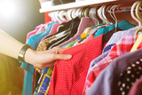 Clothes hanging on the rack in the store - 102175316