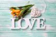 Obrazy na płótnie, fototapety, zdjęcia, fotoobrazy drukowane : Yellow spring  tulips  flowers, word love and white decorative h