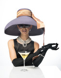 A woman in a big hat and sunglasses, like a movie star, drinking martinis