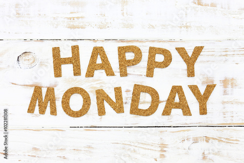 The word happy monday cork on white wood background