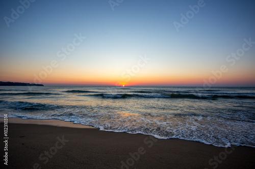 Foto op Canvas Zee zonsondergang Sonnenaufgang am Meer