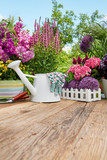 Gardening tools on wood table in the garden