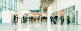 blurred people at a trade fair - 102321380
