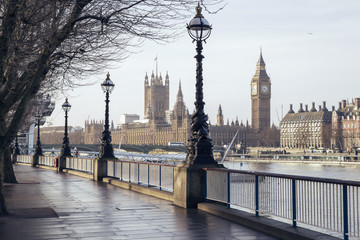 Early in the morning in central London with footpath, Big Ben and Houses of Parliament - London, UK