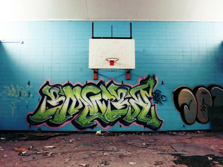 Urban basketball hoop inside abandoned school gym - landscape photo