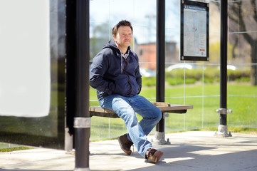 Middle age man on bus stop