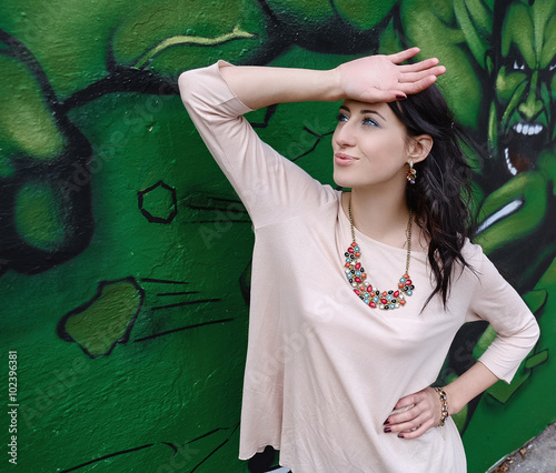 Elegant girl on graffiti background. © Aliaksandr Ivanou