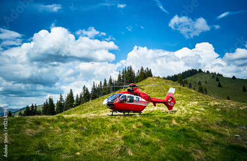 fototapeta na ścianę Helicopter takeoff in the mountains