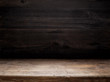 wooden table and dark wooden wall - 102551199