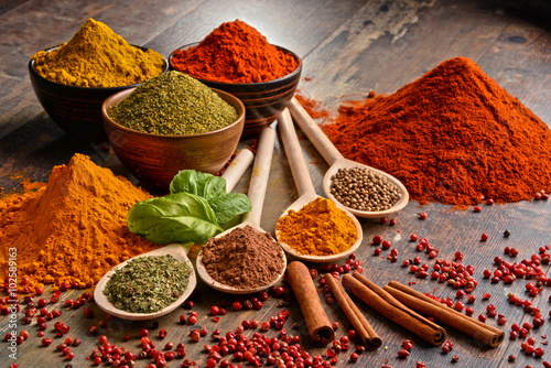 Variety of spices on kitchen table - 102589163