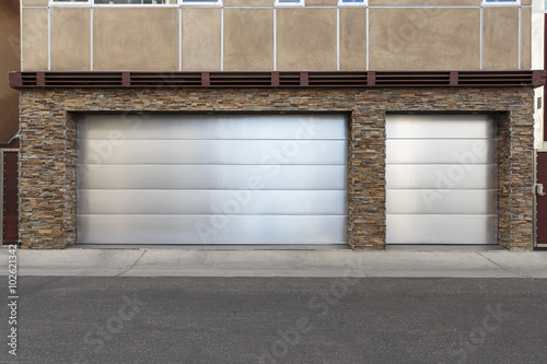 Metal Three Car Garage Door Stock Photo And Royalty Free