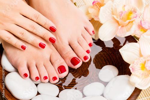 Obraz na Szkle Beautiful female feet at spa salon on pedicure procedure