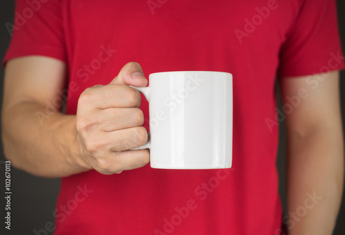 Man in red t-shirt holding Coffee mug