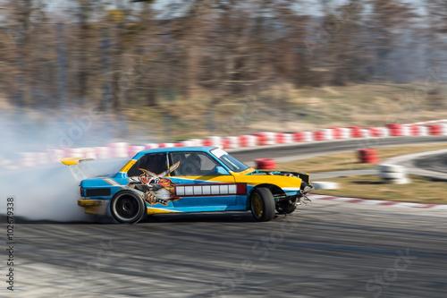 Sport car burnout on the track плакат