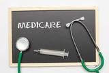 MEDICARE concept with stethoscope and syringe