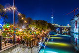 Fototapety Berlin Strandbar party at Spree river with TV tower at night, Germany
