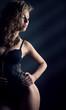 Sexy young woman stay on dark background  fashio studio shot