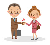 握手をするビジネスマン(中年男性と若い女性)