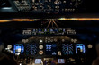 Постер, плакат: Final approach at night landing plane flight deck view