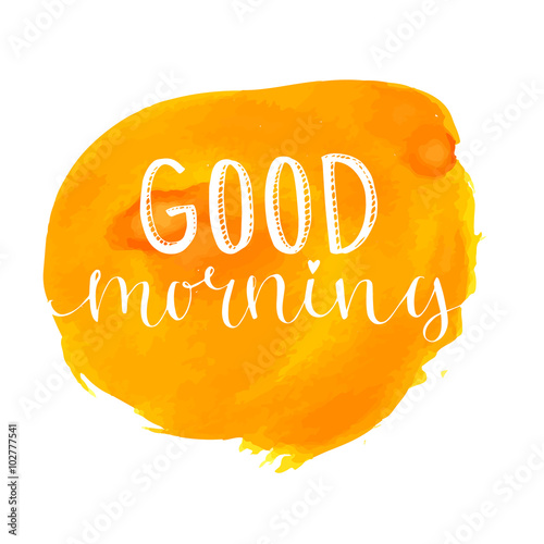 Good morning lettering at orange paint stain