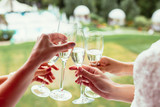 sparkling champagne glasses in girls hands on wedding day