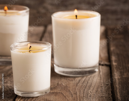 Poster scented candles on old wooden background