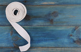 Material art background. Karate, Judo, TaeKwonDo belt on wooden table